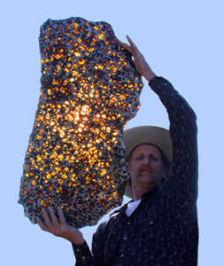 Marvin Killgore Holding Fukang Meteorite